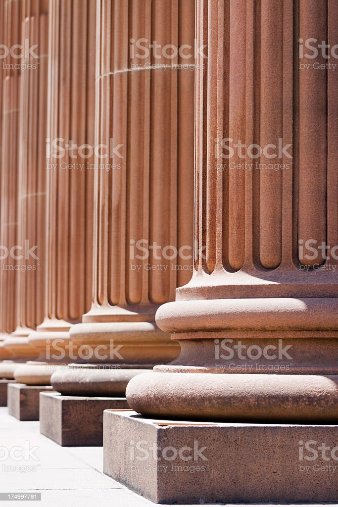 Closeup row of classical columns in sunlight royalty-free stock photo
