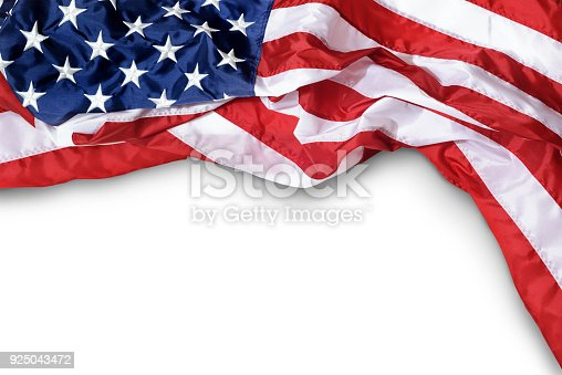 istock Closeup ruffled American flag isolated on white background 925043472