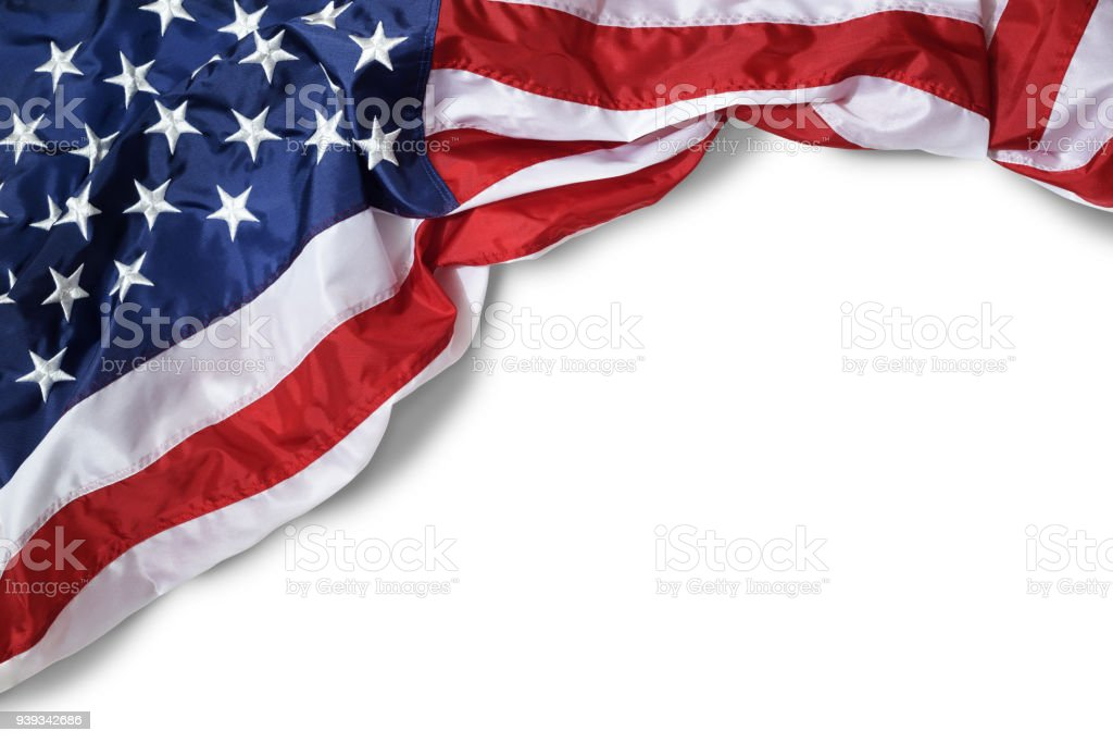 Closeup ruffled American flag isolated on white background stock photo