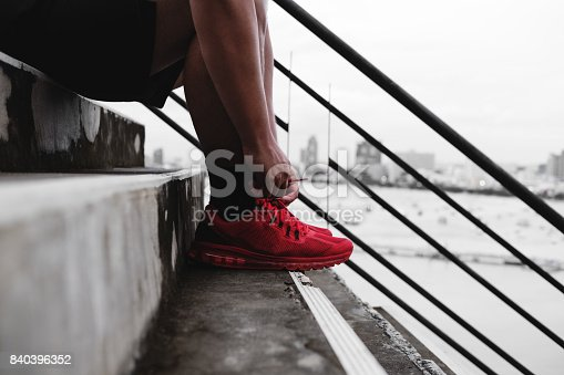 istock Close-up runner tying shoelace on the steps, healthy lifestyle 840396352