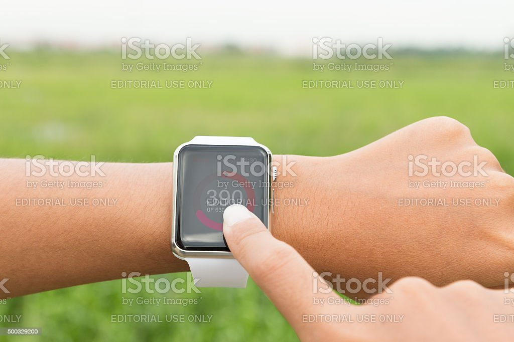 Closeup runner using Apple watch check healthy application stock photo