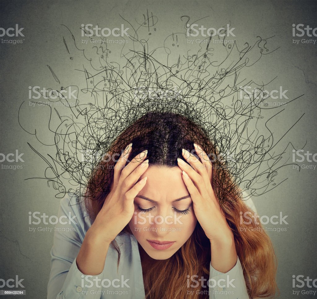 Closeup sad young woman with worried stressed face expression and brain melting into lines question marks stock photo