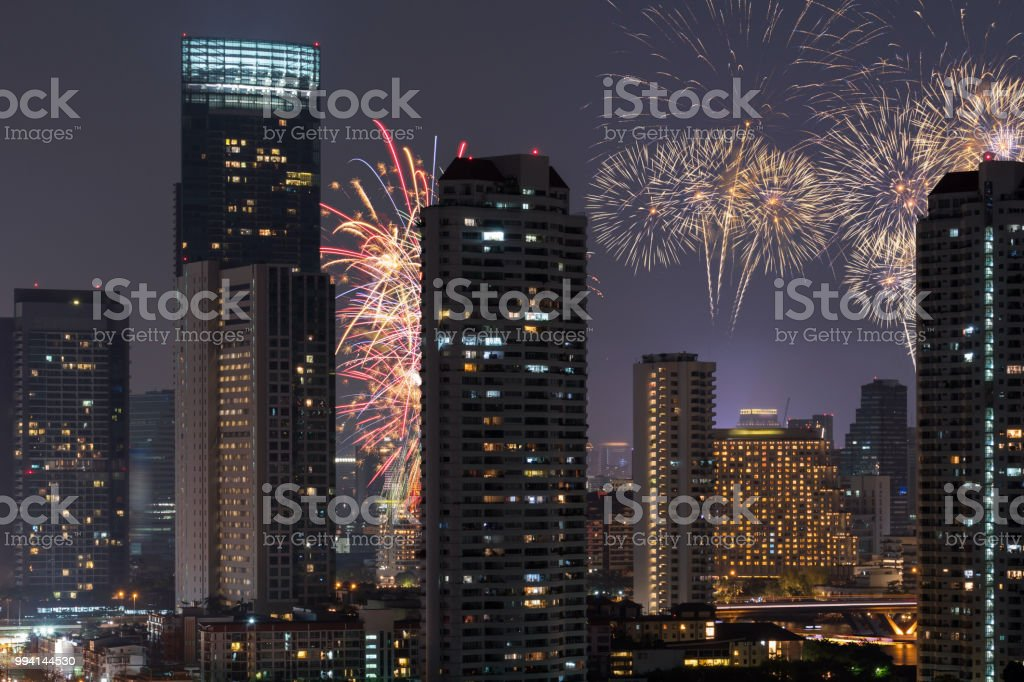 Closeup Scene Of Multicolor Fireworks With Bangkok Cityscape