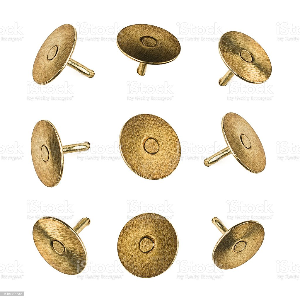 Closeup set of metal pushpins isolated on white background stock photo