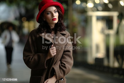 518885222istockphoto Close-up sexy woman with bright makeup and glamorous autumn clothes 1210264599