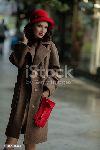 518885222istockphoto Close-up sexy woman with bright makeup and glamorous autumn clothes 1210264603