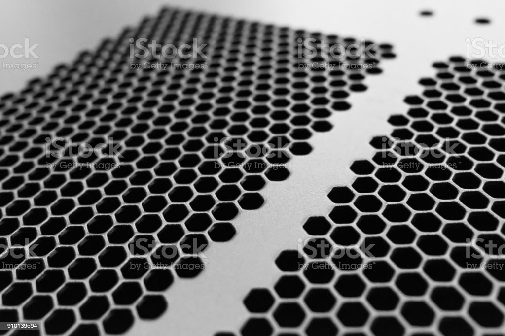 Close-up, shallow focus detail of the honeycomb venting system of a mainframe computer. stock photo