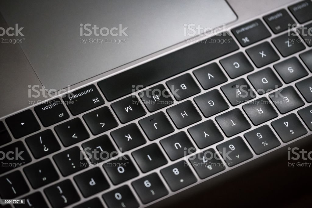 Close-up, shallow focus of a Laptop keyboard seen illuminated from the screen`s perspective. stock photo