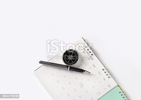 istock close-up sheet of a calendar with pen and compass 504479208