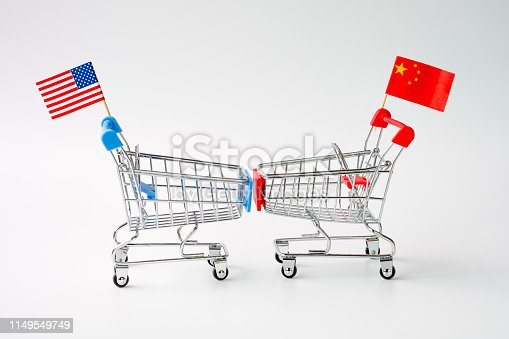 928696036 istock photo Closeup shopping cart with USA and China flag for tariff trade war between United States and China which both countries battle by increase tax barrier of import and export product. 1149549749