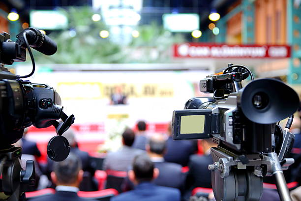 Close-up shot cameras at press conference stock photo