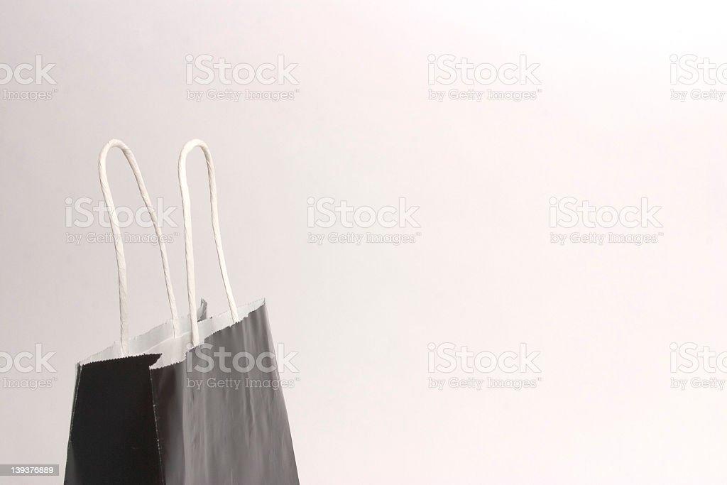 Close-up shot of a black paper shopping bag royalty-free stock photo