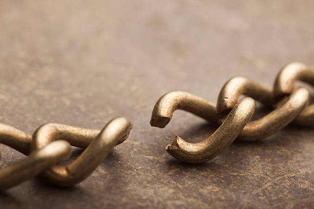 A close-up shot of a broken chain stock photo