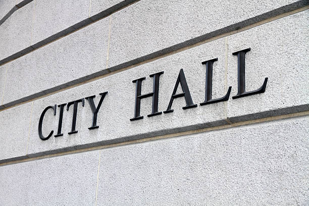 Close-up shot of a city hall sign on gray concrete wall City Hall Sign local government building stock pictures, royalty-free photos & images