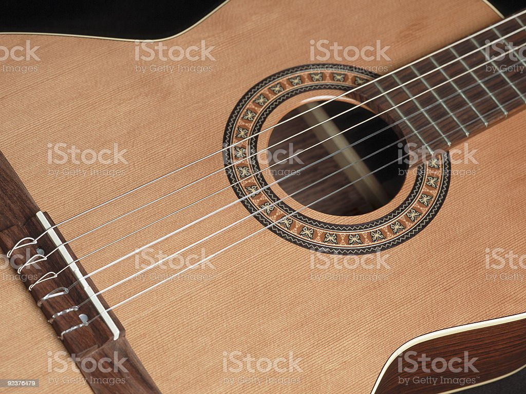 A close-up shot of a classical guitar royalty-free stock photo