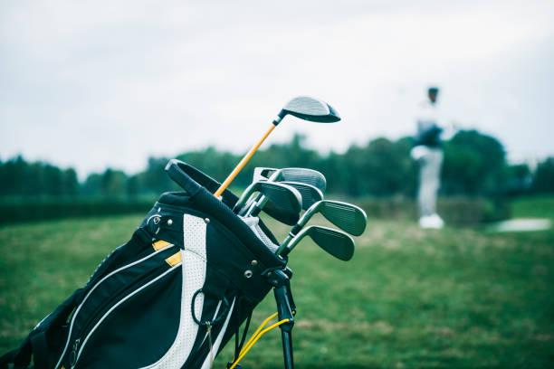 Close-up shot of a golf bag in a golf course
