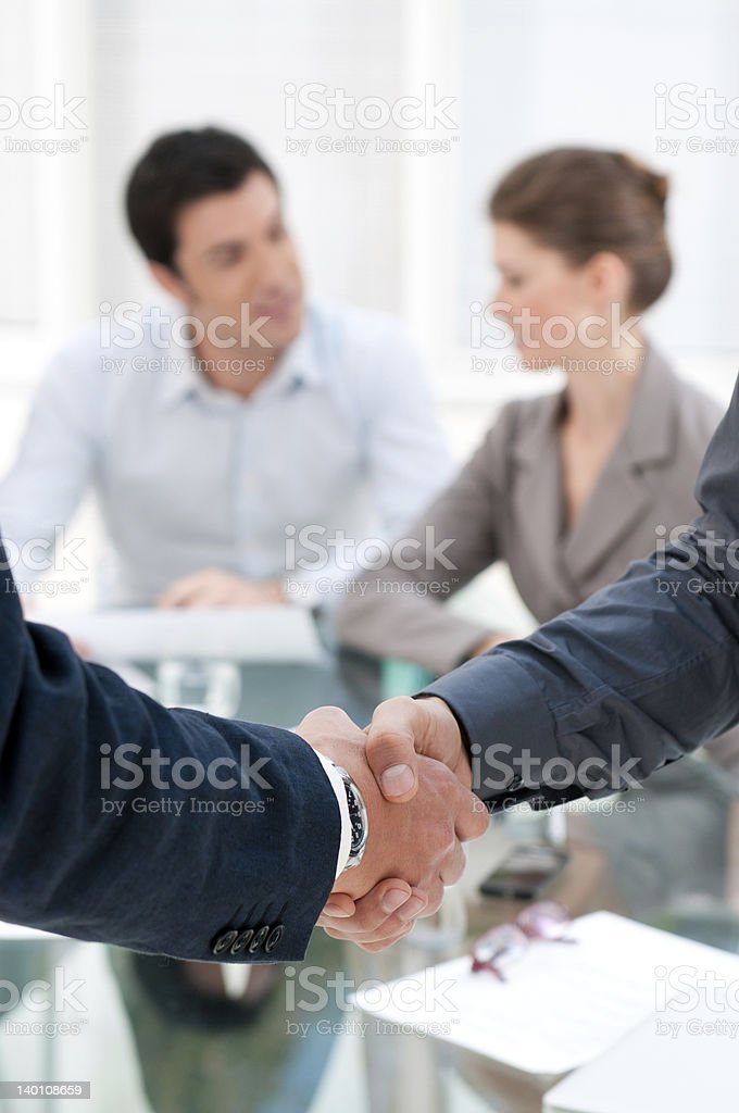 A close-up shot of a handshake of two businessmen stock photo