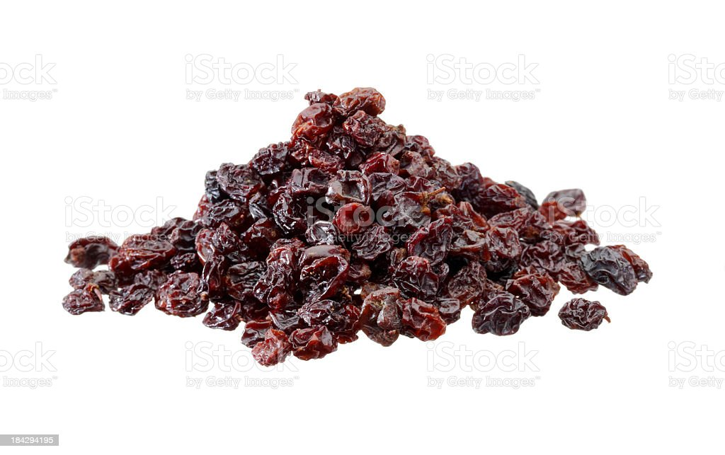 Closeup shot of a heap of raisins on white background stock photo