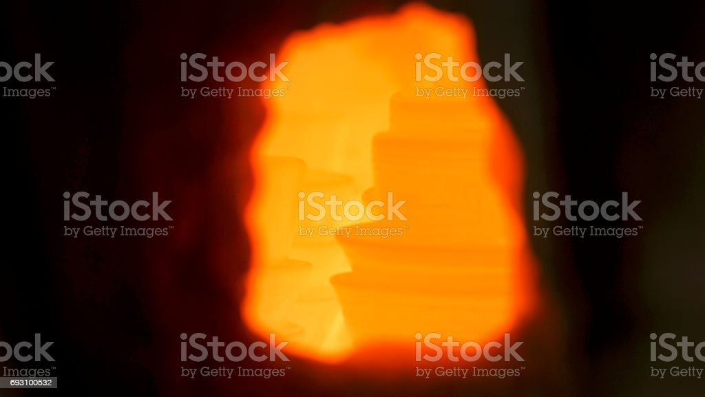 A close-up shot of a pottery burning in a kiln. stock photo