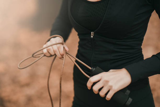 Close-up shot of a sportswoman holding a jumping rope stock photo
