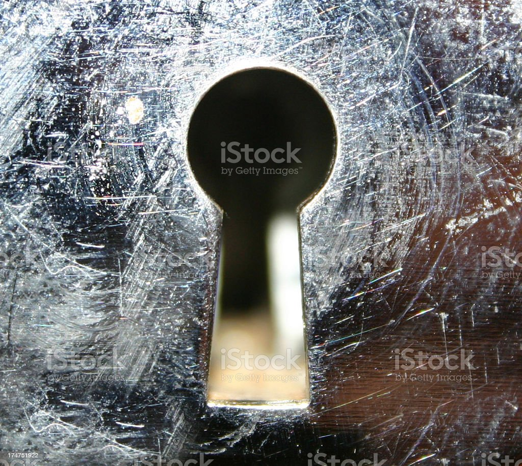 A closeup shot of a view through a metallic keyhole royalty-free stock photo
