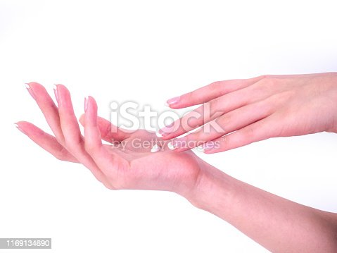 1151624350istockphoto Closeup shot of beautiful woman's hands with cream, isolated on white background, Soft skin, skincare concept. 1169134690