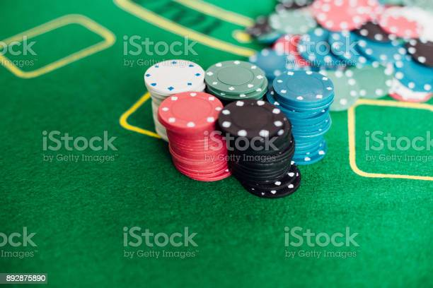 Closeup shot of casino chips on gambling table picture id892875890?b=1&k=6&m=892875890&s=612x612&h=3cfv8dna0jl 3uy7fjwn7qd0e5pftfpny01pp00p 8y=