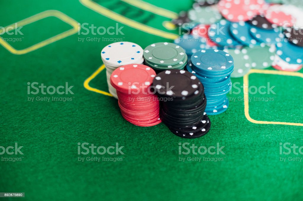 Close-up shot of casino chips on gambling table stock photo