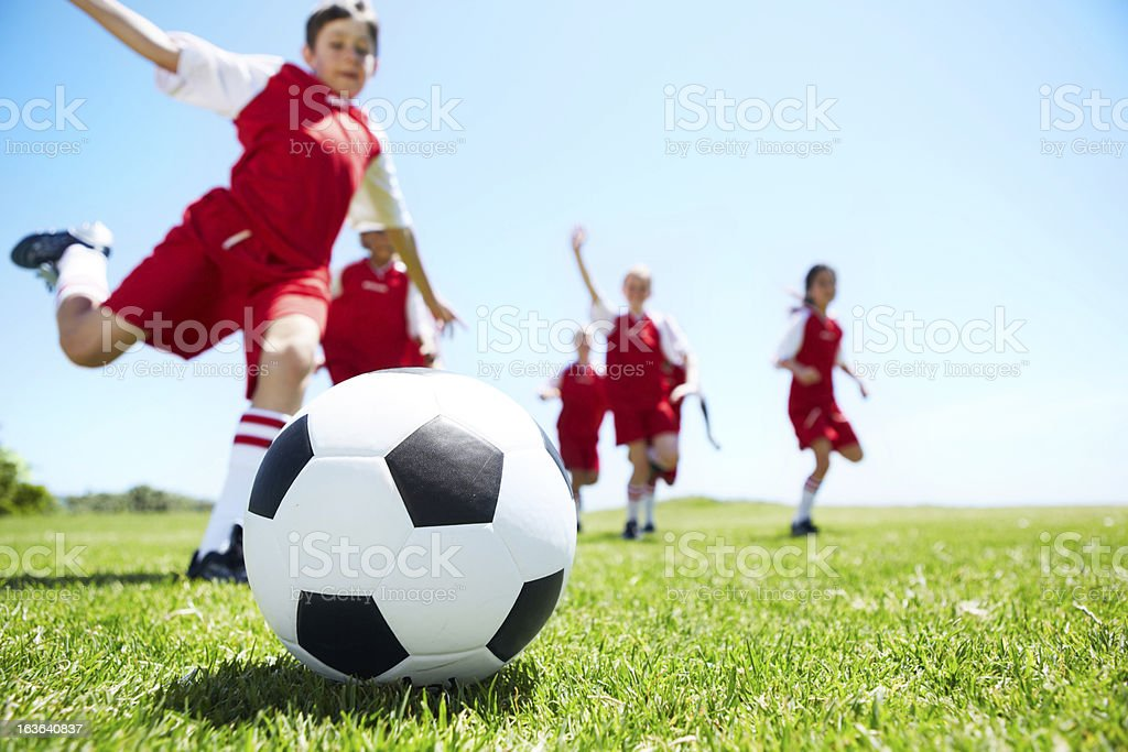 Closeup shot of children playing soccer stock photo