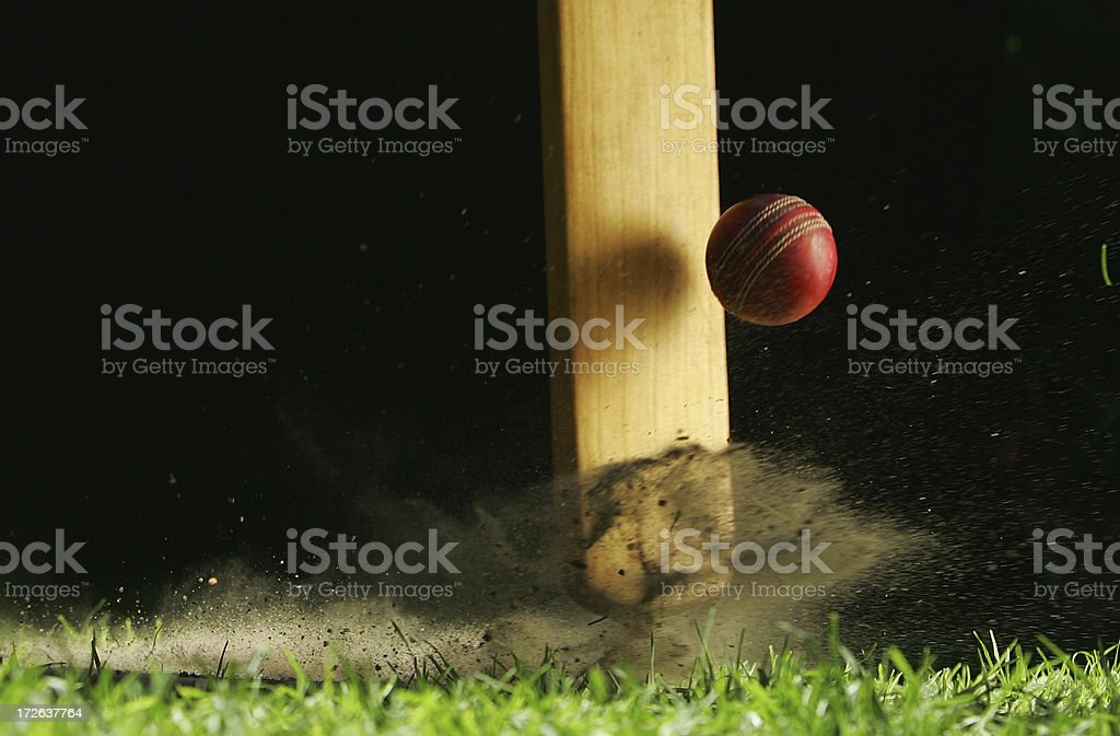Close-up shot of cricket bat hitting ball stock photo