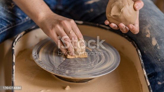 istock Closeup shot of female ceramic artist works on pottery wheel in studio space, Creative People Handcrafted Ceramic Design Art Skill 1264014334