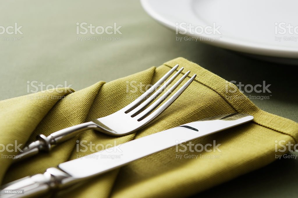 Close-up shot of green table setting with copy space stock photo