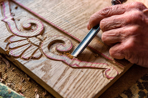 Close-up Shot of Human Hand Carving Sculpture Close-up shot of human hand working on sculpture carving craft product stock pictures, royalty-free photos & images