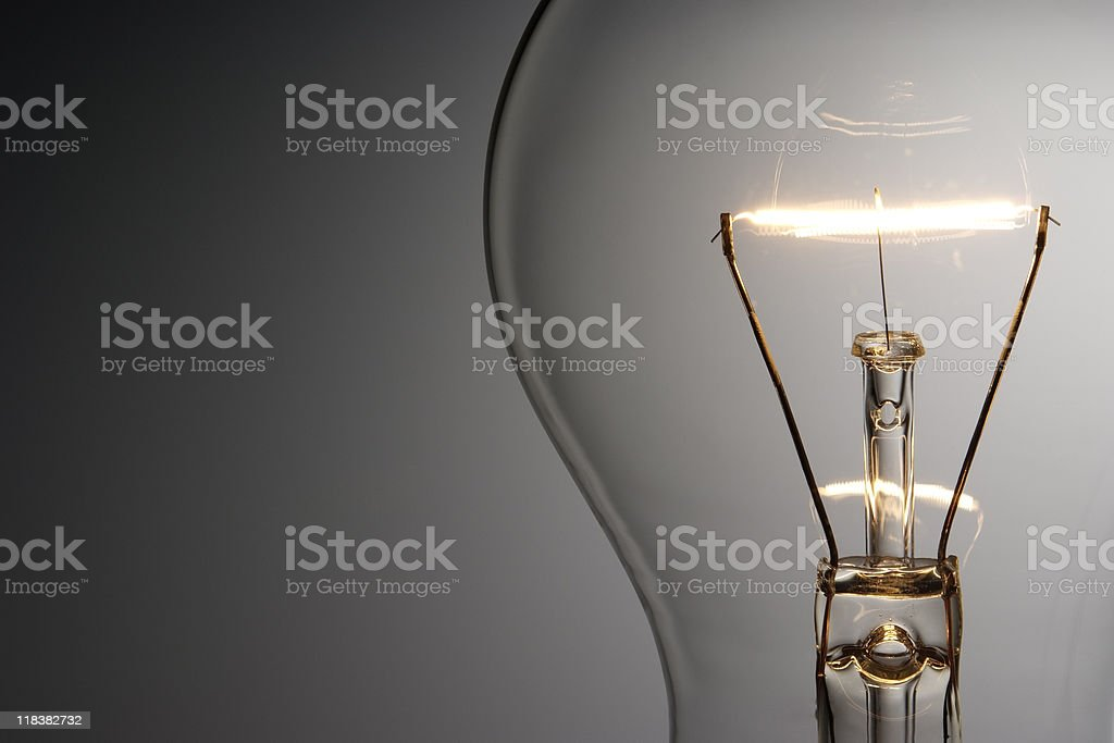 Close-up shot of illuminated light bulb with copy space stock photo