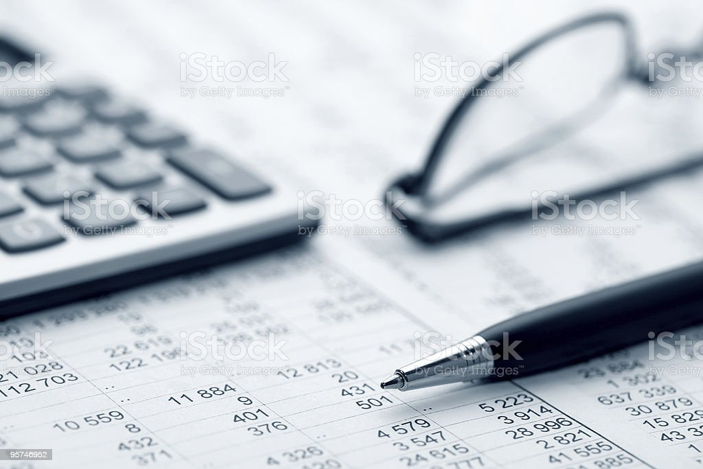 Close-up shot of ledger, pen, glasses and calculator royalty-free stock photo