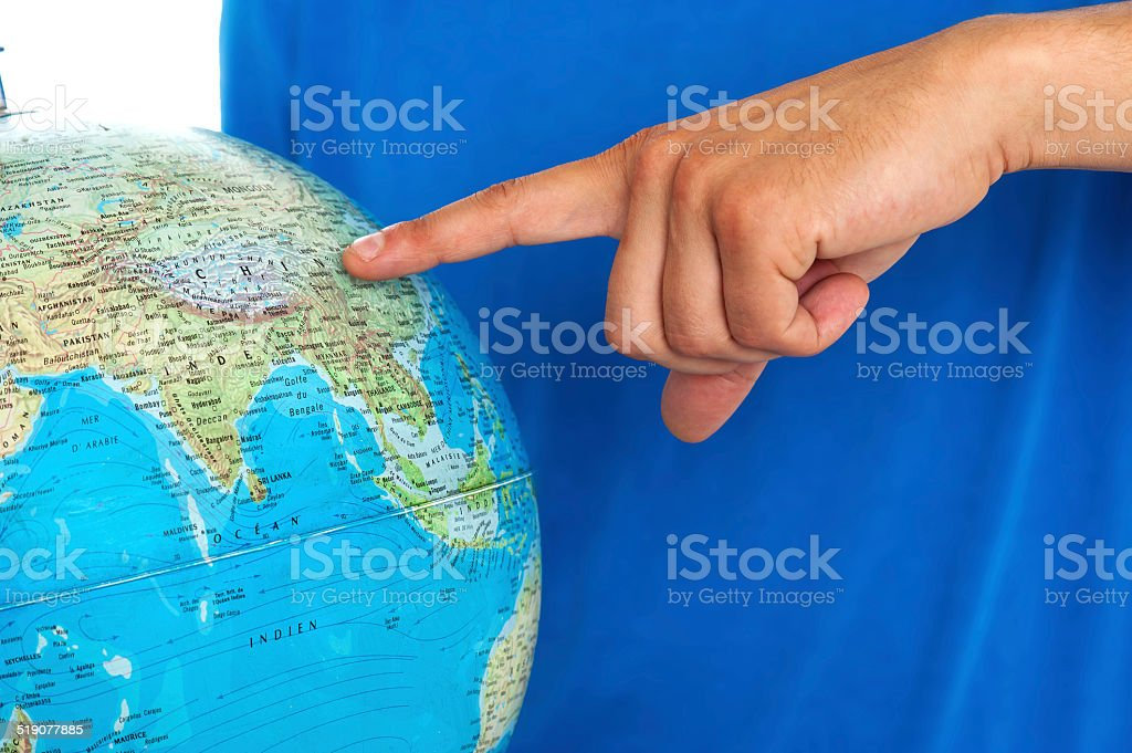 Closeup shot of male finger pointing at China stock photo