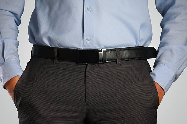 closeup shot of male waist with hands in pocket - belt stock photos and pictures