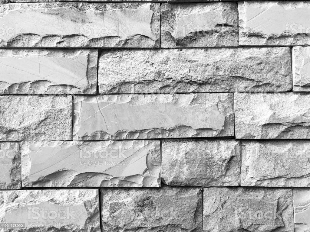 Closeup shot of modern stone tiled wall background in black and white. Horizontal stone tile pattern royalty-free stock photo