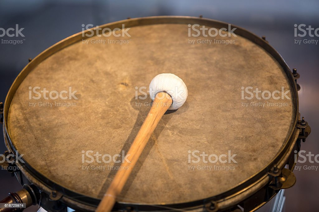 Closeup shot of old war drum with drumstick stock photo