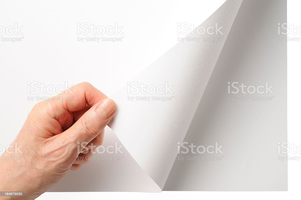 Close-up shot of opening a blank page by the hand royalty-free stock photo
