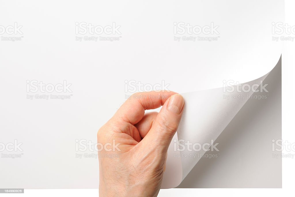 Close-up shot of opening a blank page by the hand stock photo