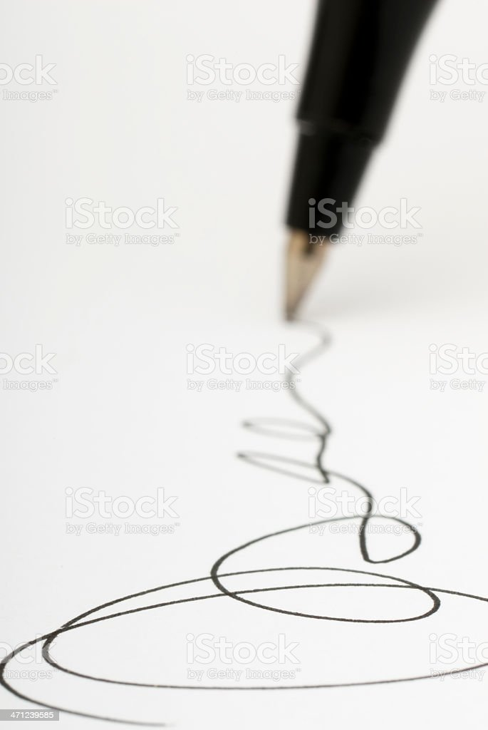 Closeup shot of pen writing signature on white paper stock photo