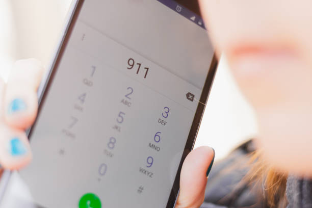 Closeup shot of phone display with the number 911 dialed stock photo