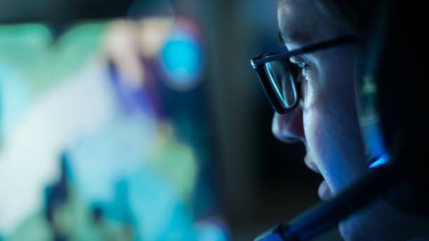 close-up shot of professional gamer plays in mmorpg/ strategy video game on his computer. he's participating in online cyber games tournament, plays at home, or in internet cafe. he wears glasses and gaming headsets. - esports stock photos and pictures