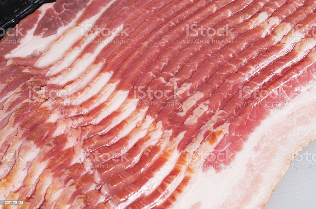 Close-up shot of raw bacon slices stock photo