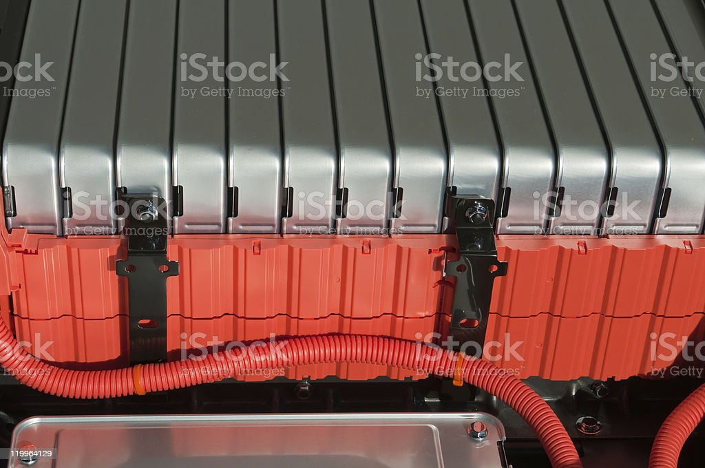 Close-up shot of red and gray battery pack of electric car stock photo