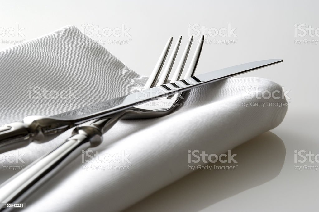 Close-up shot of silverware on white napkin stock photo