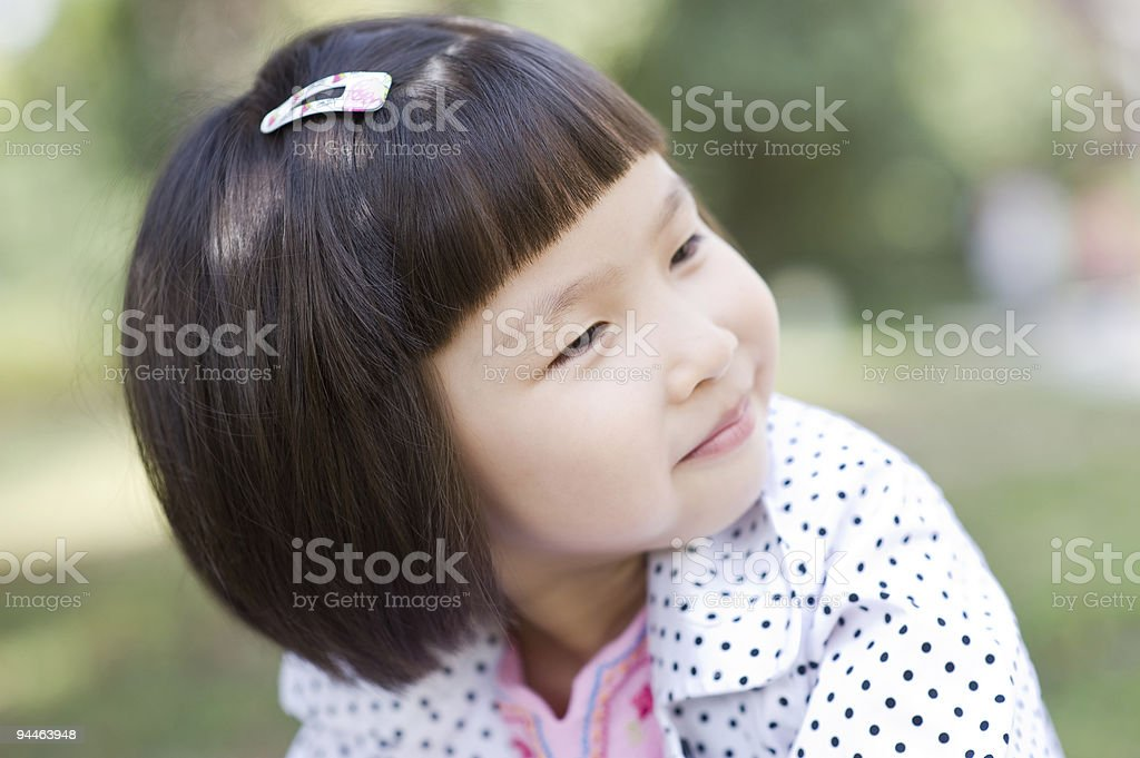 close-up shot of smiling asian little girl royalty-free stock photo