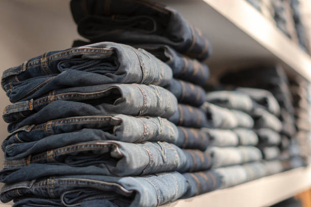 Closeup shot of stack of folded jeans stock photo