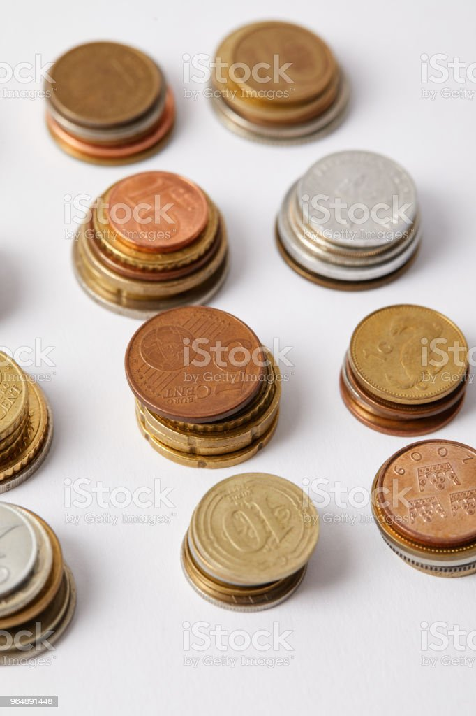 close-up shot of stacks of different coins on white royalty-free stock photo